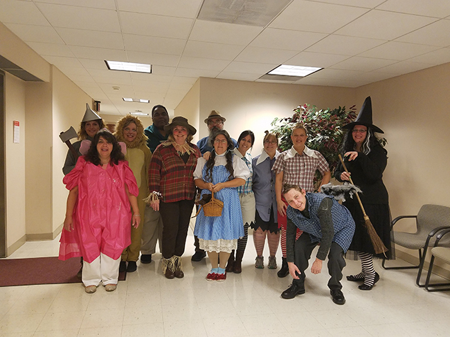 Photo of Treasurers Office dressed as the cast of Wizard of Oz for Halloween.